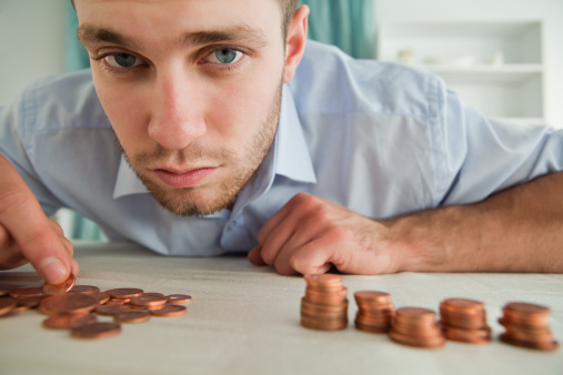 Businessman counting his change